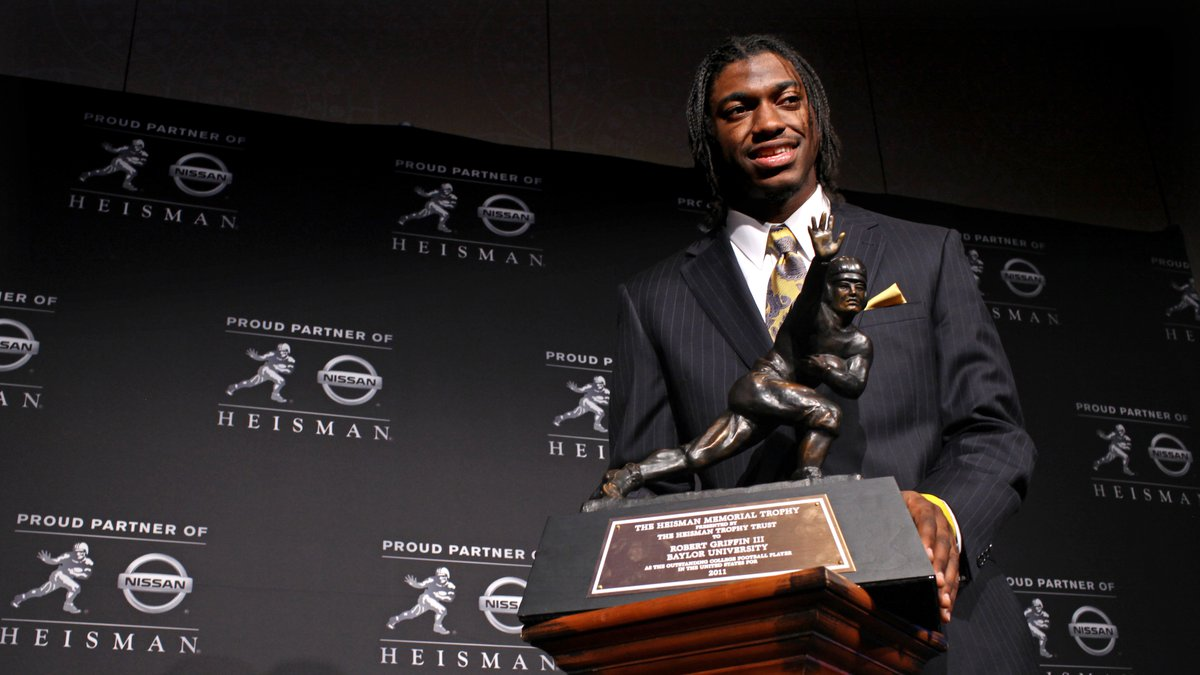 Heisman Trophy winner Robert Griffin III, of Baylor, is photographed with the award during a...