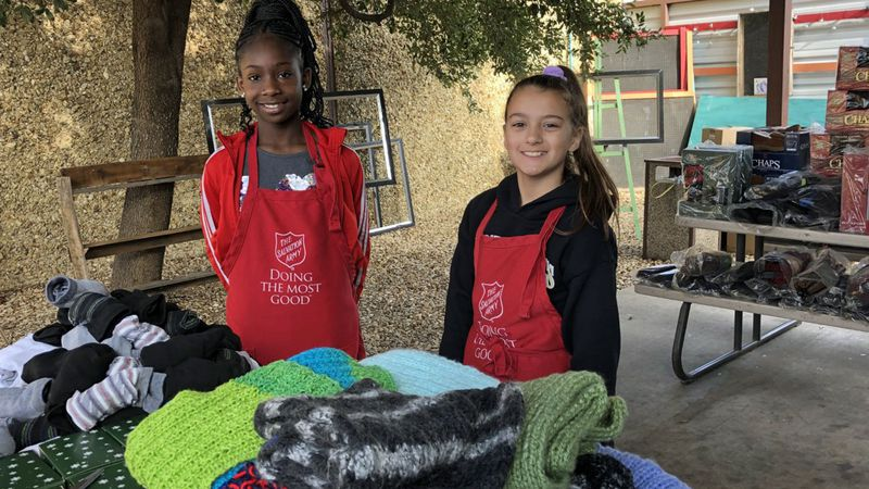 If your finances are tight, you can donate your time, as these two young volunteers are doing.