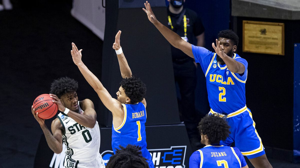 Michigan State's Aaron Henry (0) is defended by UCLA's Jules Bernard (1), Tyger Campbell (10),...
