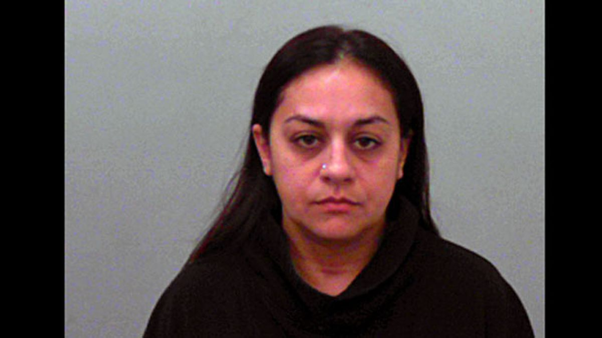 Louisa Theresa Hernandez, 37, was arrested Tuesday on a warrant charging improper relationship between educator and student. (Jail photo)