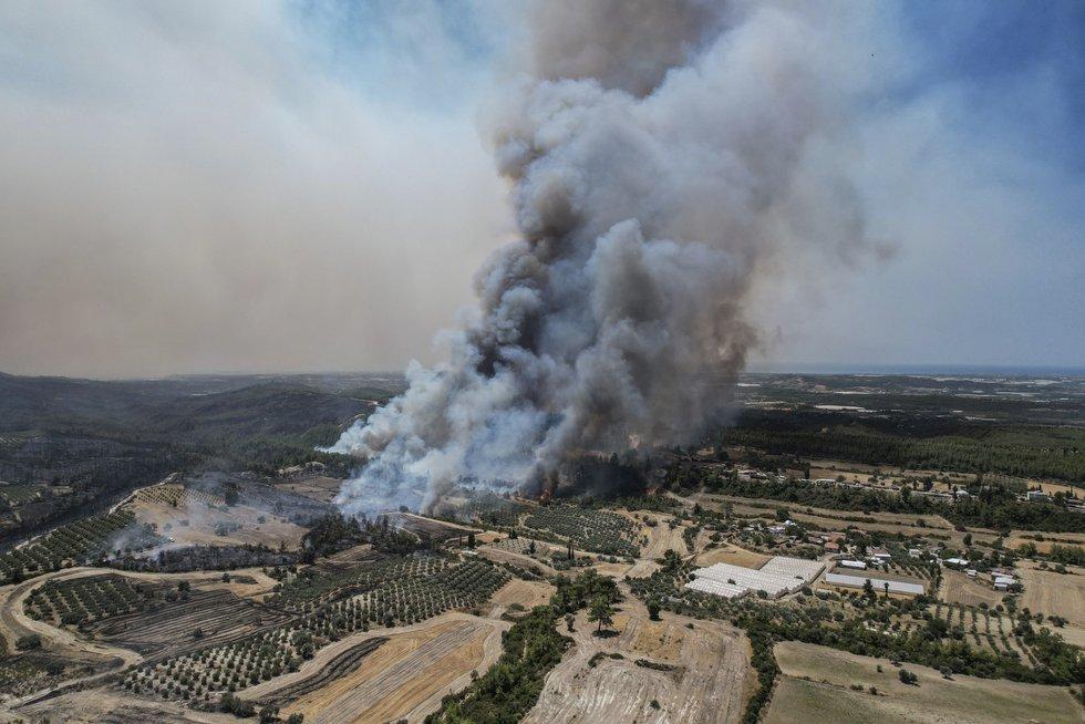 An aerial photo shows wildfires in Kacarlar village near the Mediterranean coastal town of...