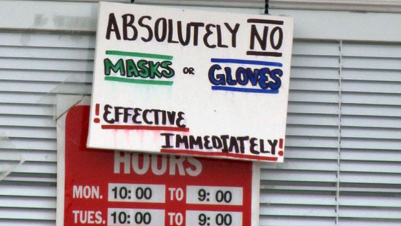 The store's owners say the put up the sign in an effort to protect employees after the...