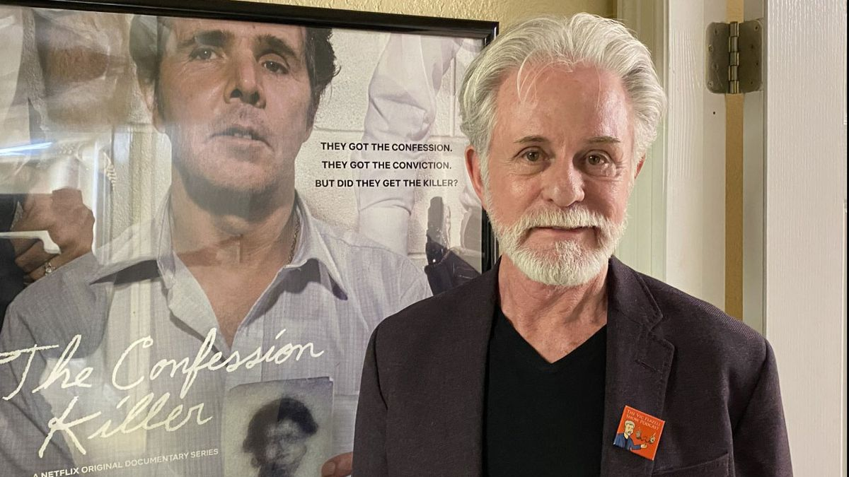 Former McLennan County District Attorney Vic Feazell beside a poster for the new movie. (Photo by Drake Lawson)