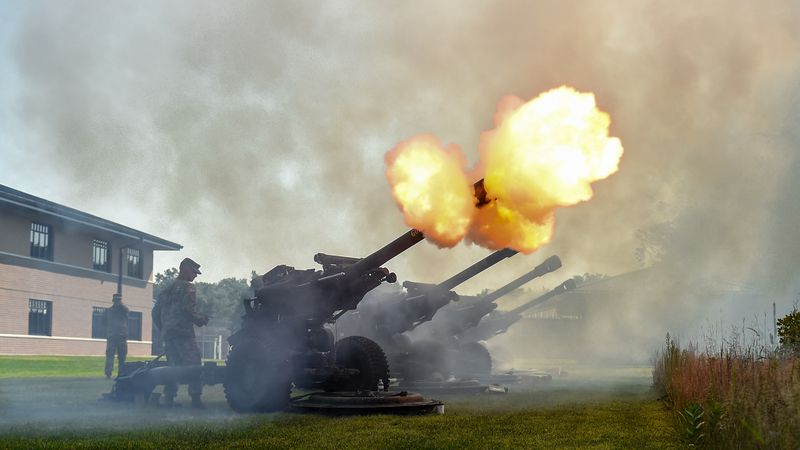A howitzer cannon fires off a blank round during a 21-gun salute.  (U.S. Army photo by Sgt....