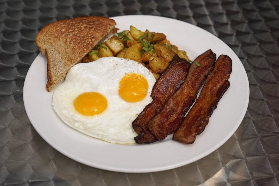 Jeannie Kim's popular bacon and eggs breakfast is seen outside her restaurant in San Francisco...