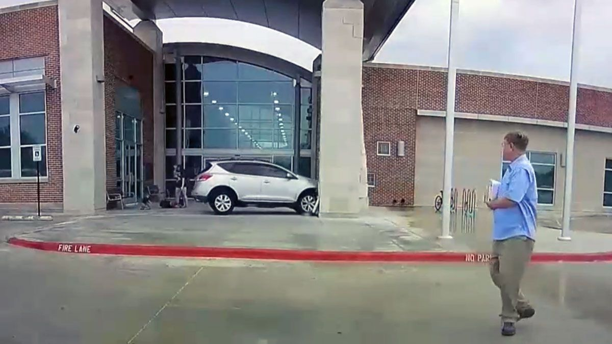 The SUV's driver was trying to pull into a handicapped parking space when he hit the gas. (KBTX)