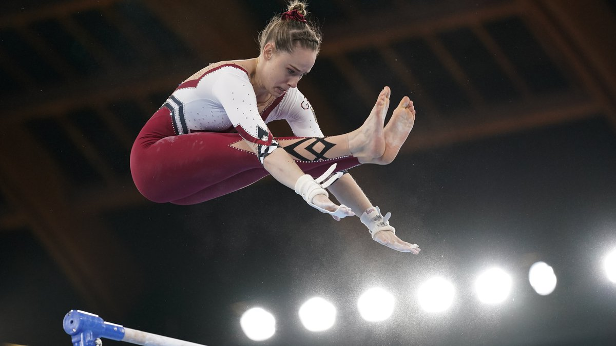 Sarah Voss, of Germany, performs on the uneven bars during the women's artistic gymnastic...