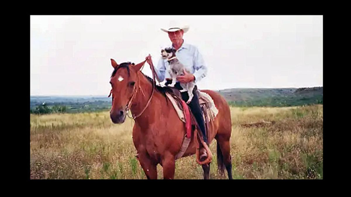 Raymond Reeves rides a horse at his Donley County ranch in the early 2000s.