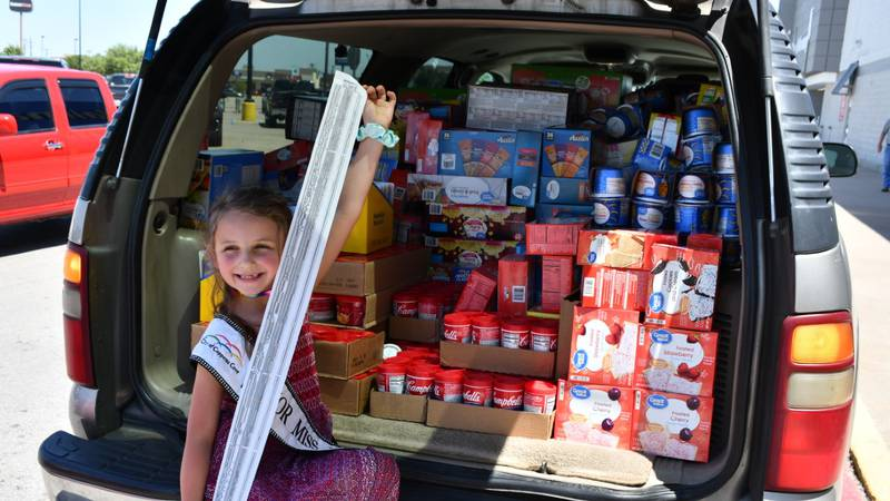 Junior Miss Five Hills 2020 Kadence Coombs with the long receipt from food purchased to start a...