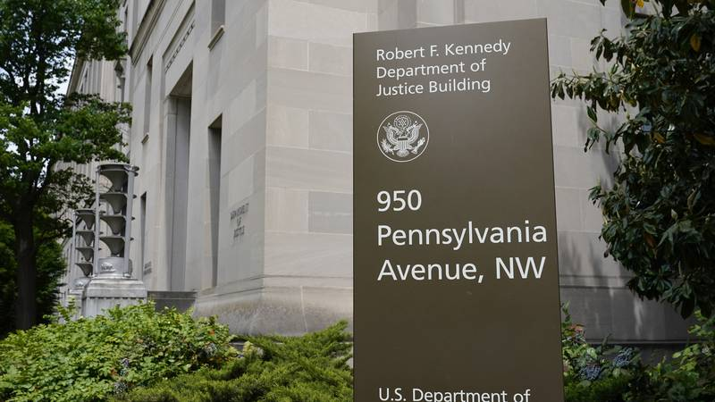 FILE - This May 4, 2021 file photo shows a sign outside the Robert F. Kennedy Department of...