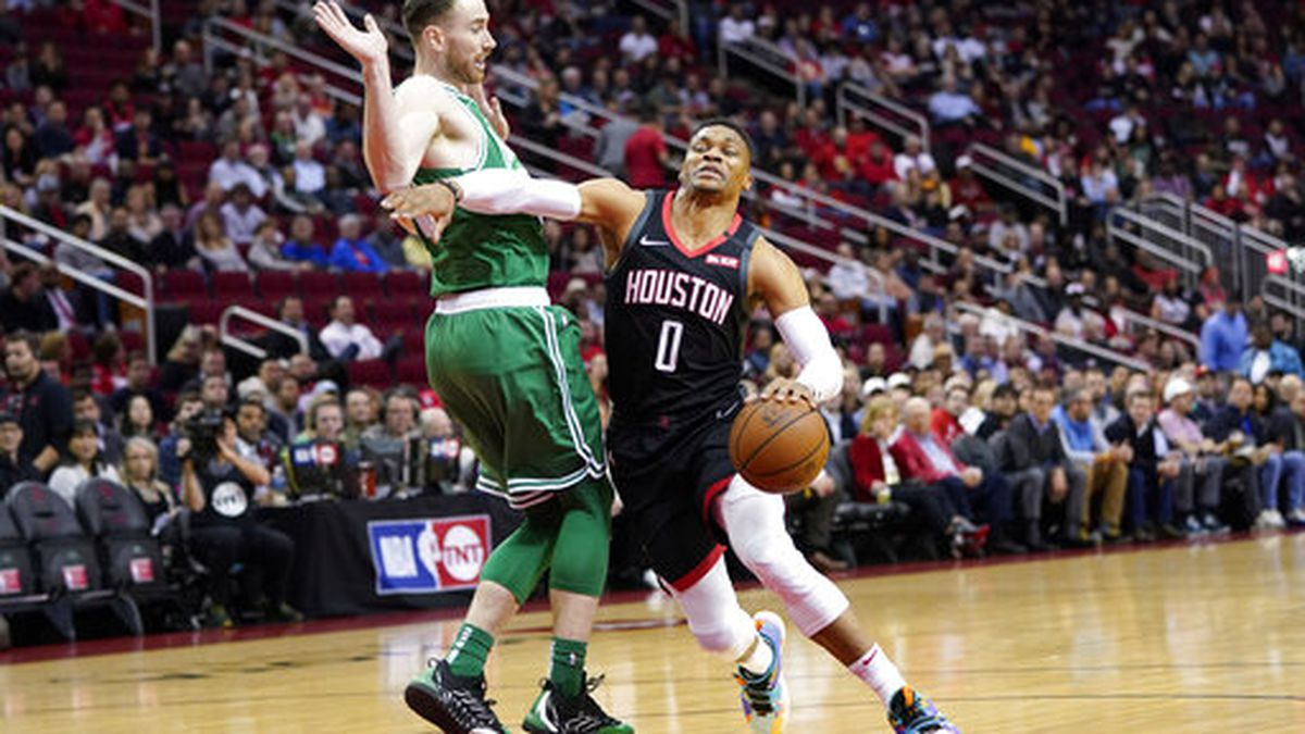 Houston Rockets' Russel Westbrook (0) is fouled by Boston Celtics' Gordon Haywood during the first half of an NBA basketball game Tuesday, Feb. 11, 2020, in Houston. (AP Photo/David J. Phillip)