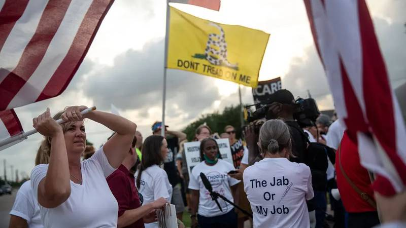Medical personnel rallied against Houston Methodist Hospital's COVID-19 vaccine mandate outside...