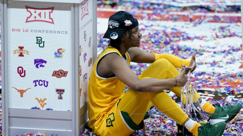 Baylor's NaLyssa Smith celebrates after winning an NCAA college basketball game against West...