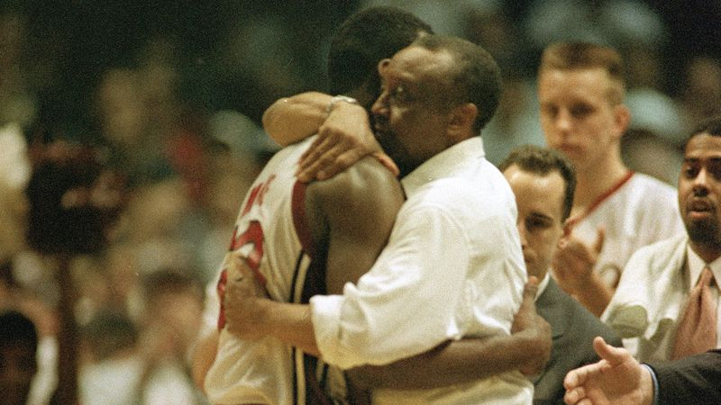 Temple coach John Chaney embraces senior guard Aaron McKie at the end of their game with...