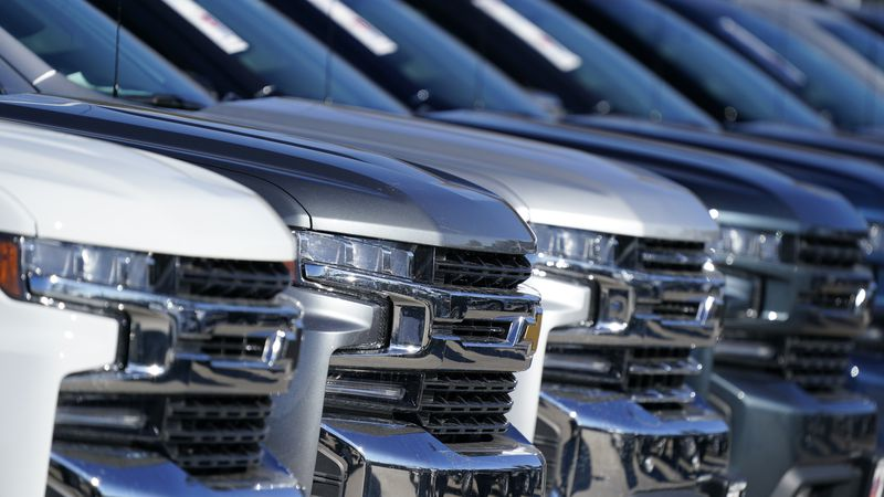 A long line of unsold 2021 Silverado pickup truck sits at a Chevrolet dealership Sunday, Nov....