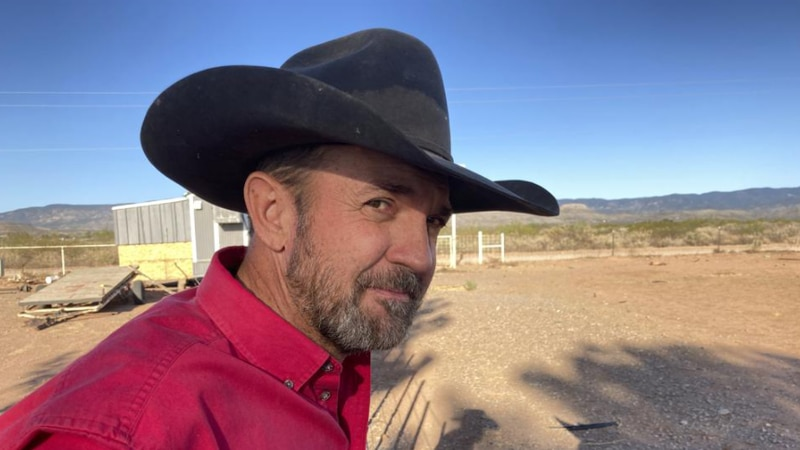 Otero County Commissioner Couy Griffin, the founder of Cowboys for Trump, takes in the view...