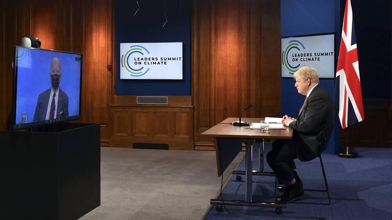 FILE - In this April 22, 2021 file photo, British Prime Minister Boris Johnson listens to U.S....