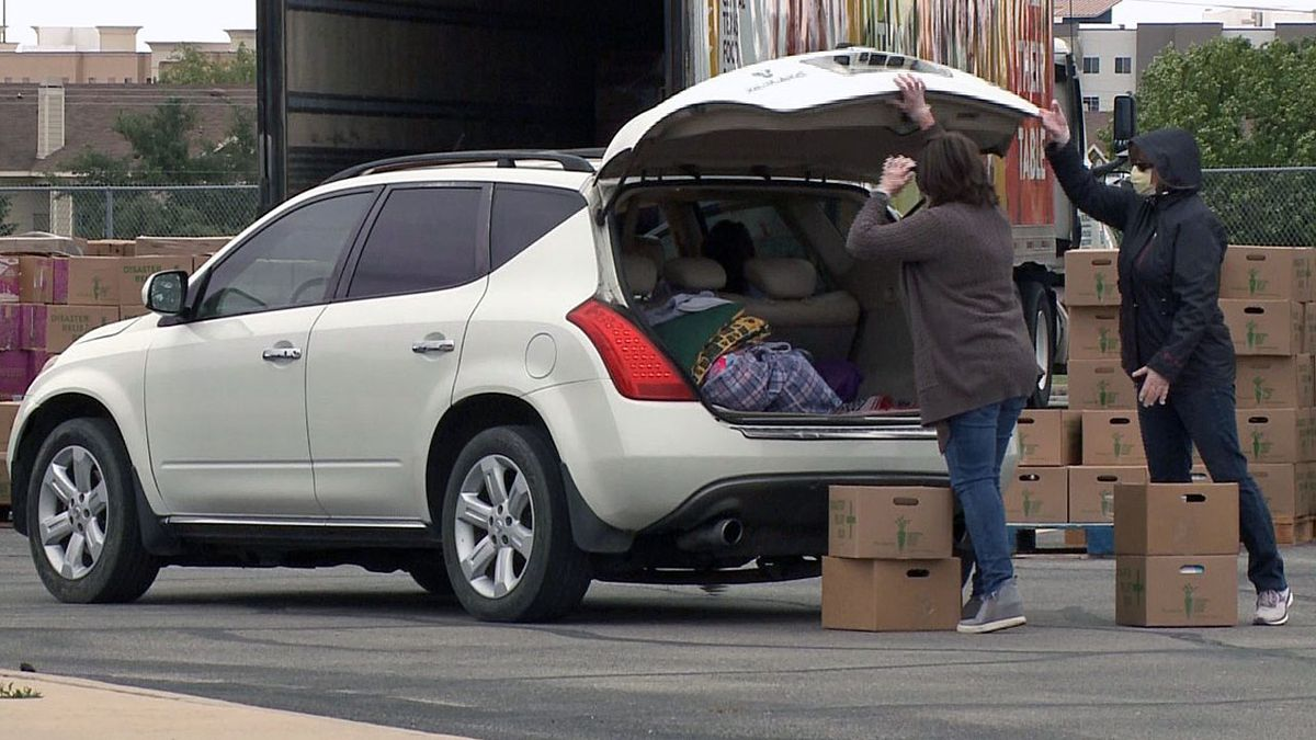 The Central Texas Food Bank handed out boxes of food Thursday in Waco. Another drive-thru distribution is planned next week. (Photo by Hannah Hall)