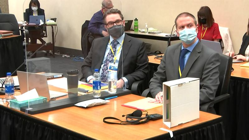 In this image from video, defense attorney Eric Nelson, left, and former Minneapolis police...
