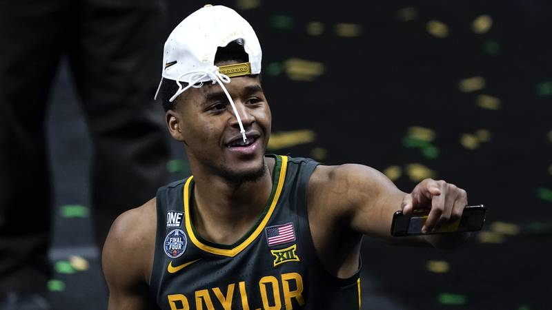 Baylor guard Jared Butler celebrates as he walks off the court after the championship game...
