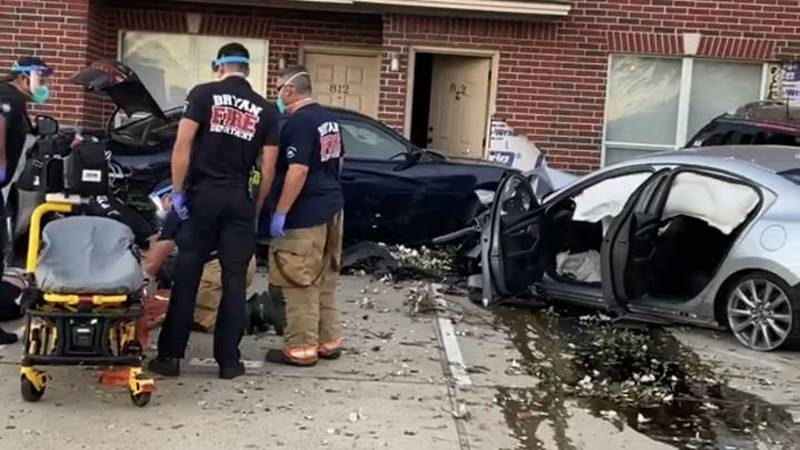 Bryan firefighters and medics evaluate a driver after he crashed into several vehicles in the...