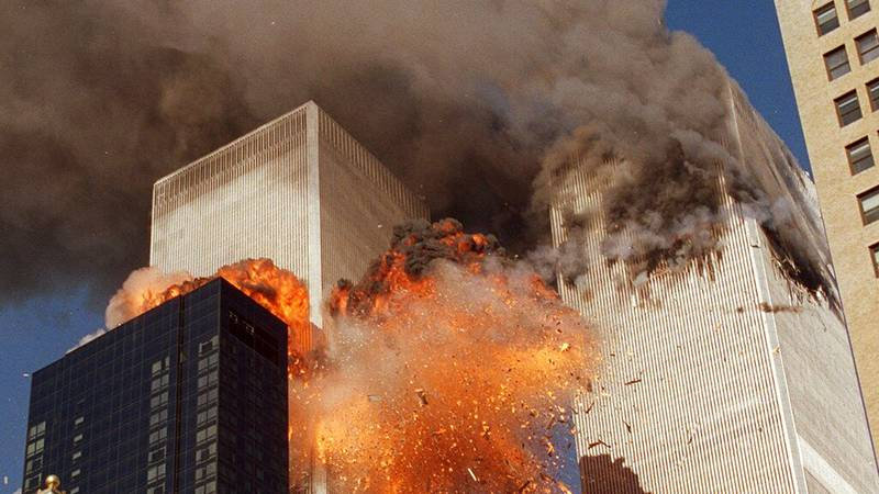 FILE: Smoke billows from one of the towers of the World Trade Center and flames as debris...