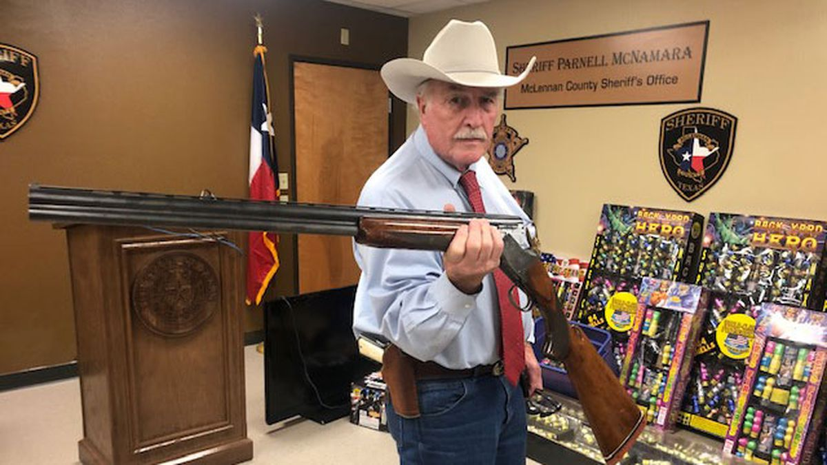 McLennan County Sheriff Parnell McNamara with one of the guns that deputies recovered. (Photo by John Carrroll)