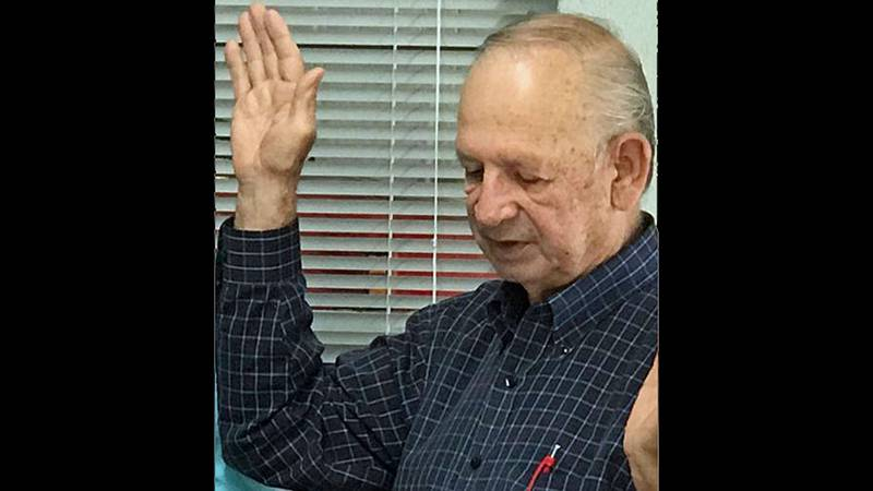 Johnnie Hauerland taking the oath of office after winning another term as Meridian's mayor in...