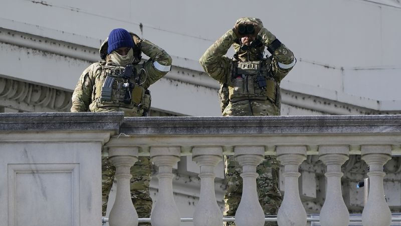 FBI officers work security for the inauguration of President Joe Biden on the East Front of the...