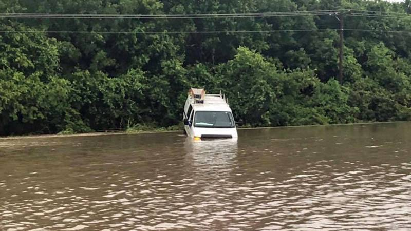 Hewitt officers rescued the driver of this van, which ended up partially submerged in high...