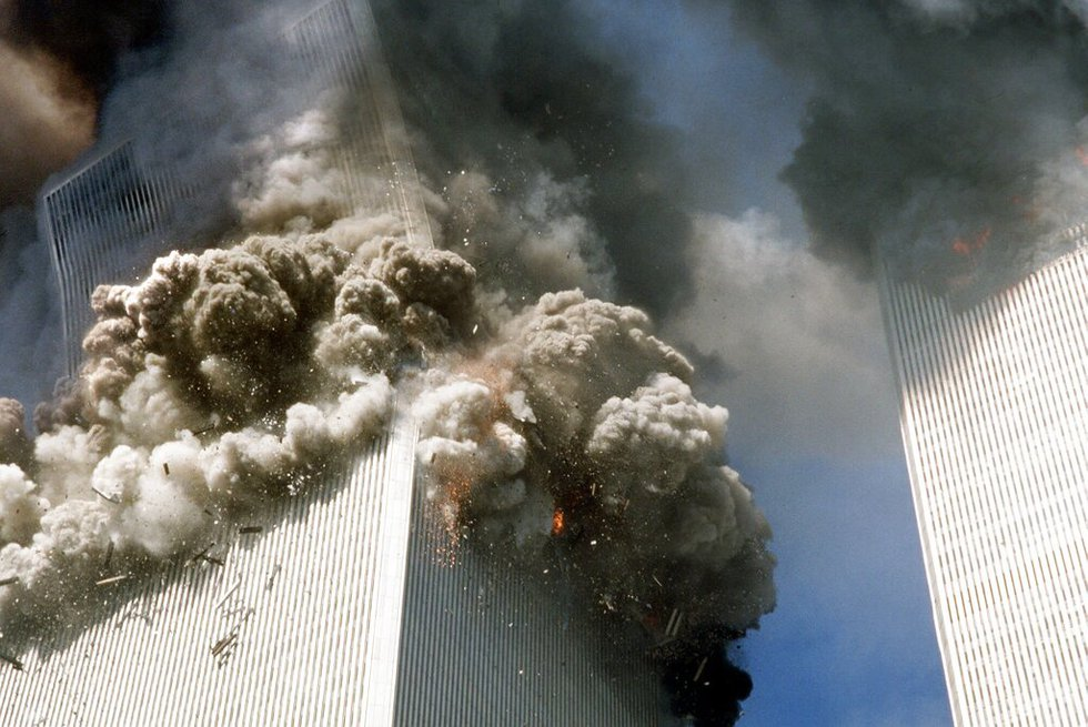 The south tower of the World Trade Center, left, begins to collapse after a terrorist attack on...