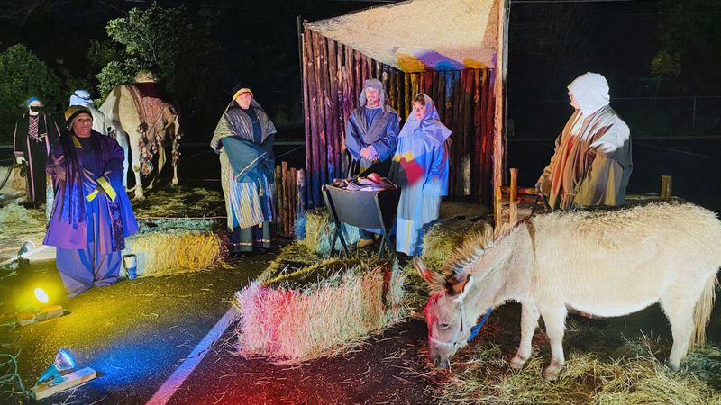 Singers greeted visitors who then drove past 11 different scenes that told the story of Jesus'...