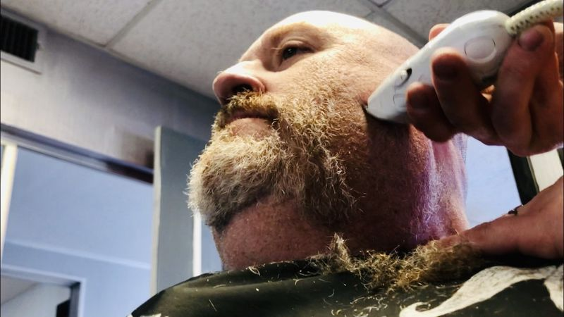 West PD officer Arthur McGilton shaves off his beard Tuesday as part of No Shave November and...