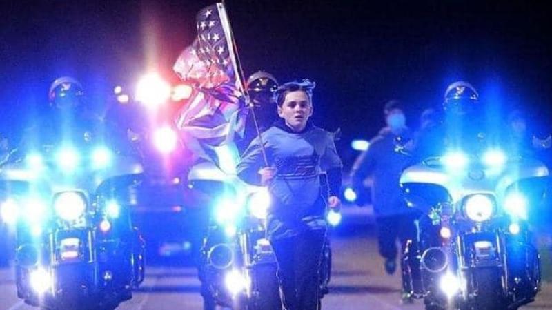 Zecheriah Cartledge runs in honor of fallen law enforcement officers and firefighters.