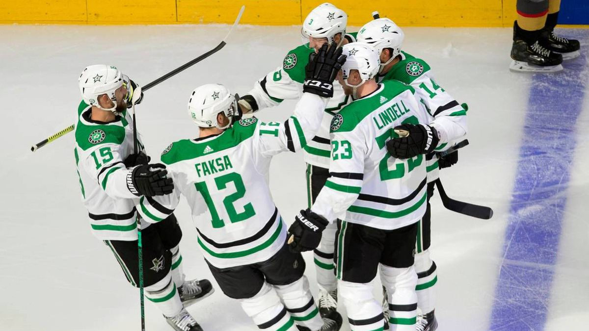 Dallas Stars' Blake Comeau (15), Radek Faksa (12), Esa Lindell (23), Jamie Benn (14) and John Klingberg (3) celebrate a goal by Klingberg against the Vegas Golden Knights during the first period of Game 1 of an NHL Western Conference final hockey game, Sunday, Sept. 6, 2020 in Edmonton, Alberta.