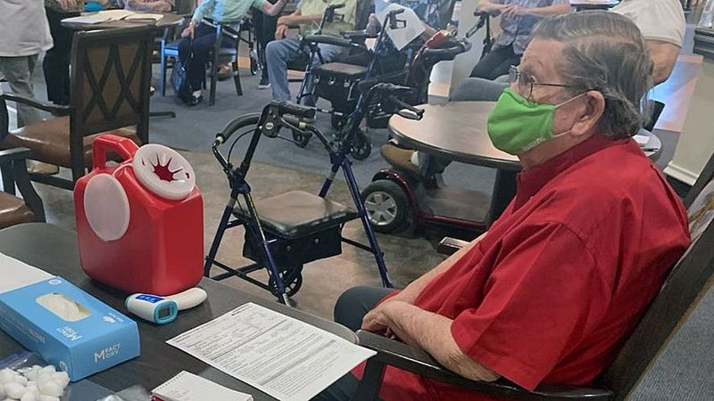 Residents and employees of a local nursing home received their first doses of the Pfizer...