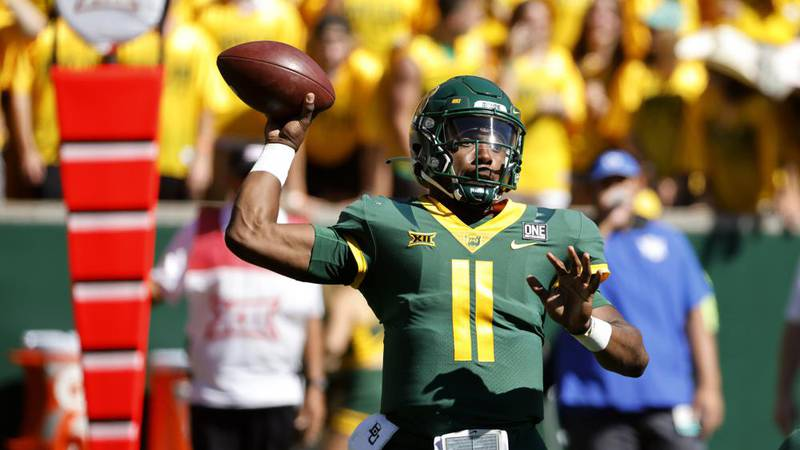 Baylor quarterback Gerry Bohanon (11) throws against BYU during the first half of an NCAA...