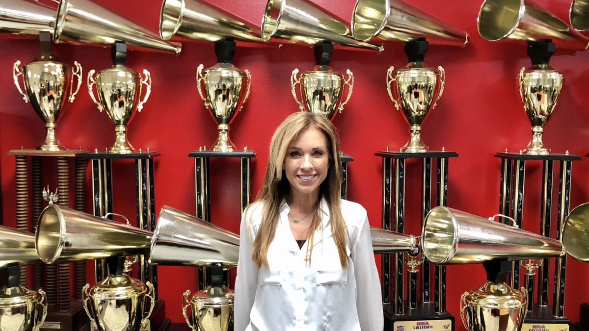 Monica Aldama, Head Cheer Coach at Navarro College, poses with her 14 National Championship...