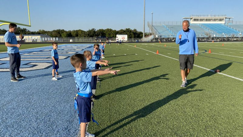 China Spring AD Mark Bell coaches his grandsons.