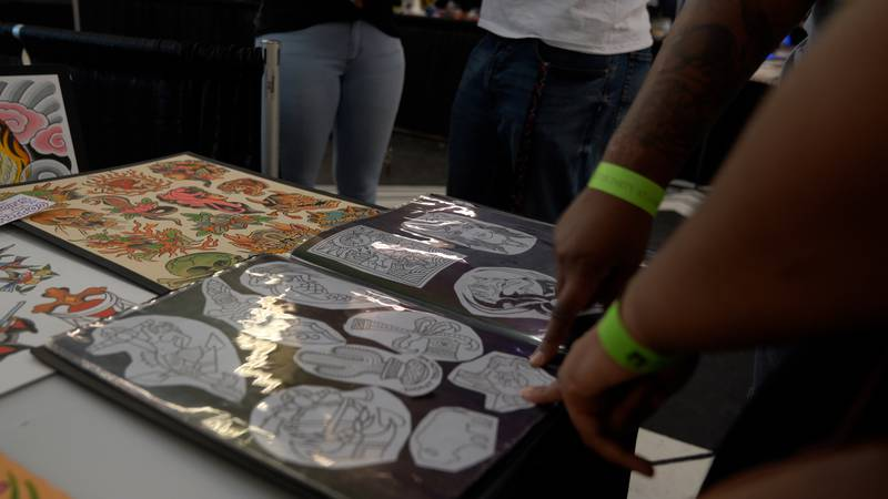 Eager customers pick out their next tattoo at the 10th annual Lowbrow Tattoo Convention.