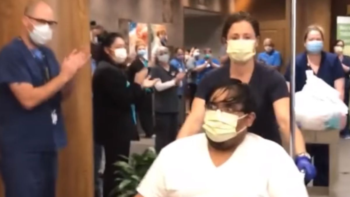 Hospital staff lined the hallway as Ascension Providence celebrated the discharge of its first...