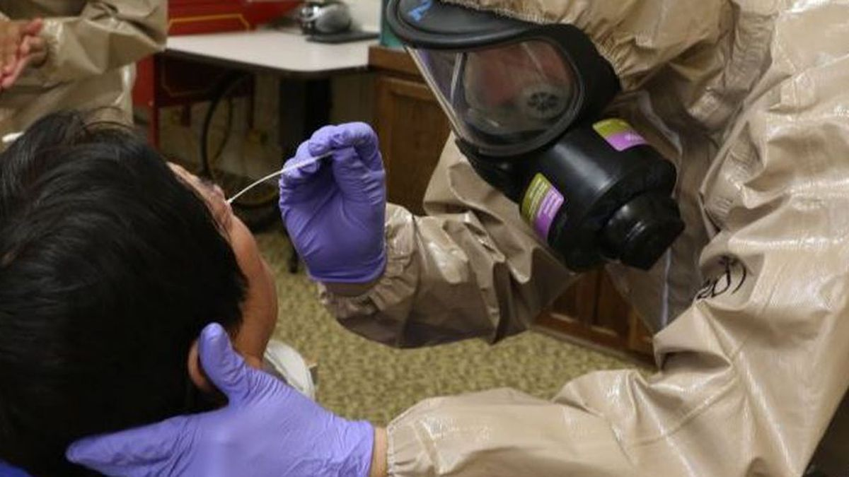 Virginia National Guard Soldiers and Airmen collect samples for COVID-19 testing at a long-term...