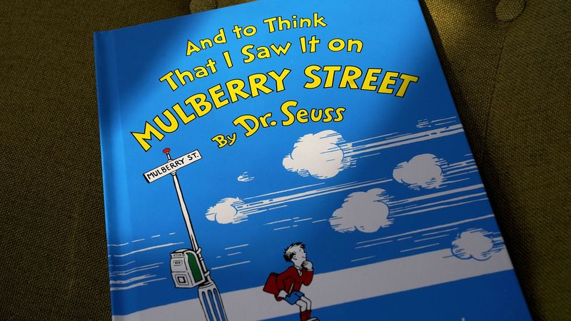 "A copy of the book ""And to Think That I Saw It on Mulberry Street,"" by Dr. Seuss, rests in a..."