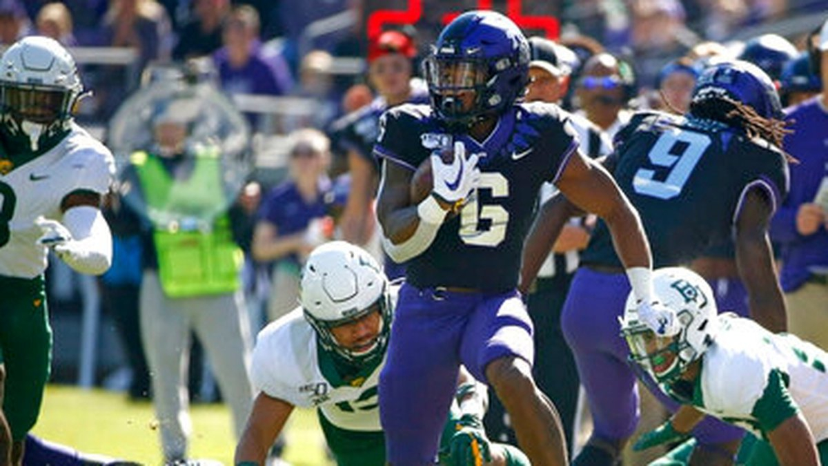 TCU running back Darius Anderson (6) carries the ball against Baylor during the first half of...