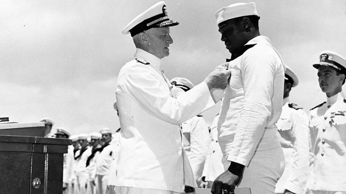 Adm. Chester Nimitz presented the Navy Cross to Doris Miller on May 27, 1942. (U.S. Navy...
