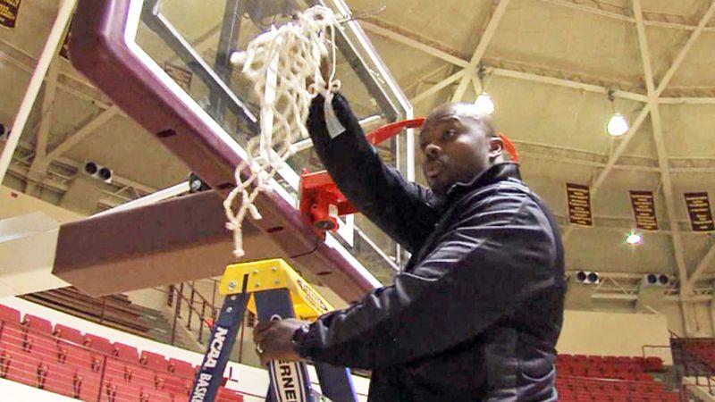 Former MSU head coach Nelson Haggerty cutting down the net after winning a regular season...