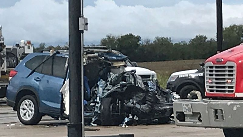 At least one person died Friday morning in a highway crash involving an SUV and an RV, which...