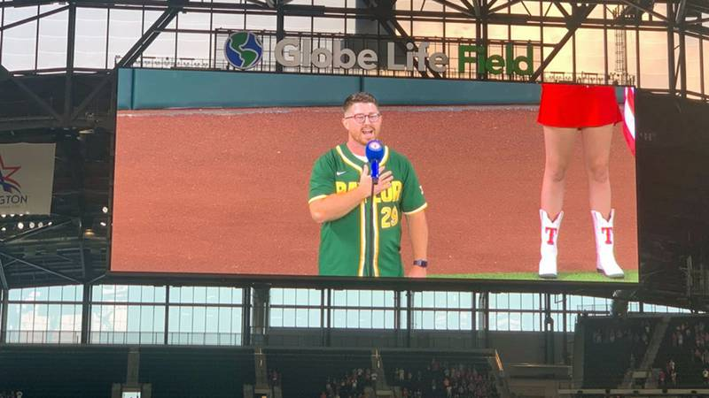 Art Wellborn singing the national anthem just before the first pitch Friday at Globe Life Field.