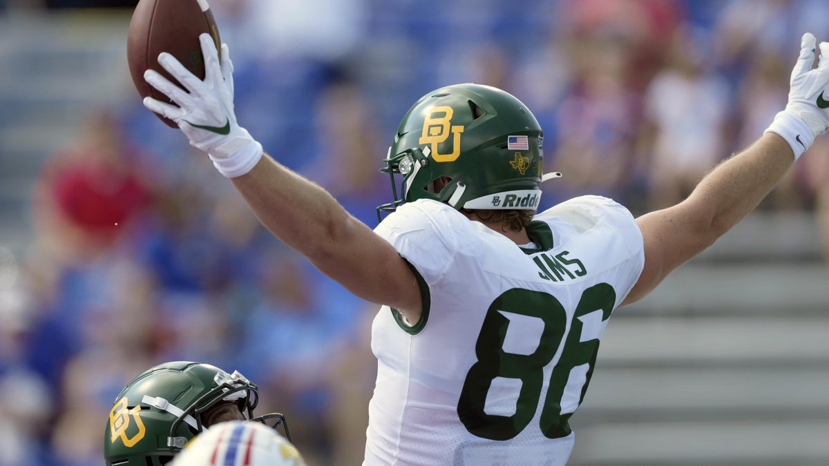 Baylor tight end Ben Sims (86) celebrates a touchdown during the first half of an NCAA college...