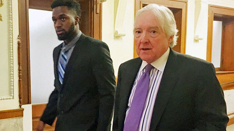 Sam Ukwuachu (left) and his attorney, William Bratton III of Dallas, after a hearing. (Photo by...